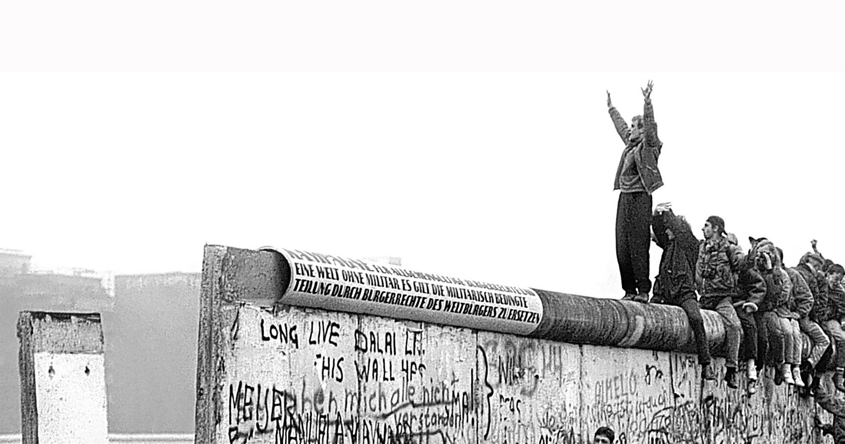 Protestors on Top of Berlin Wall
